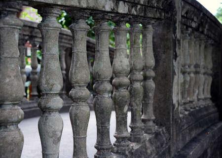 Row of gray mortar balustrades. It is the bar of the bridge. Archivio Fotografico