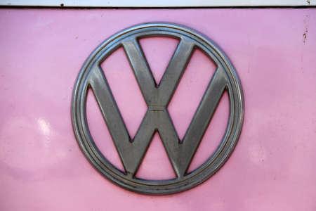 Samkhok, Pathum Thani, Thailand, July 1, 2018 : Metal logo of Volkswagen on pink background. It is the logo of Volkswagen van.