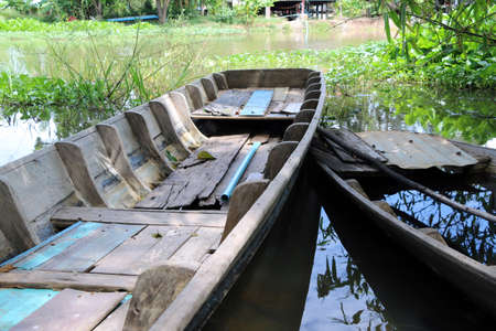 Local sampan boat of Thailand in the canal, One available and another one not available because boat Leak, Full of water inside.