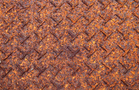 Rusty metal plate floor texture background. texture plate rust Background of steel plate floor in brown color with rusty iron. a reddish or yellowish-brown flaky coating of iron oxide that is formed on iron by oxidation, especially in the presence of moisture.