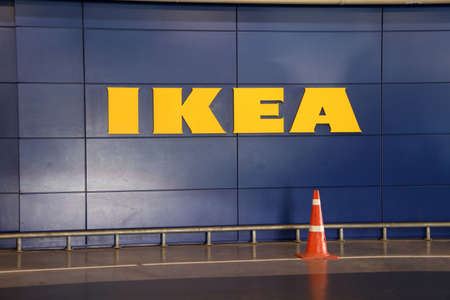 Bang Phli, Samut Prakan, Thailand, Jan 7, 2018 : IKEA yellow sign on blue wall, IKEA is a Big furniture retailer and sells furniture, appliances and home accessories. Founded in Sweden in 1943. Editorial