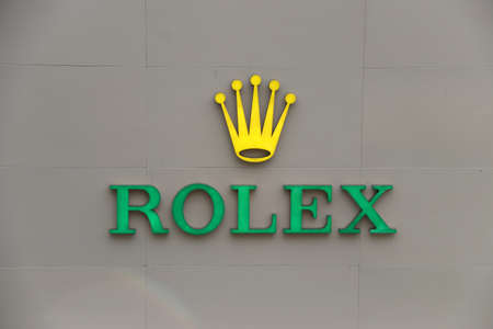 Bangkok, Thailand, Feb 1, 2018: Light sign of Rolex watch logo in front of a store in Pathumwan, Bangkok. Rolex brand founded by Alfred Davis and Hans Wilsdorf.