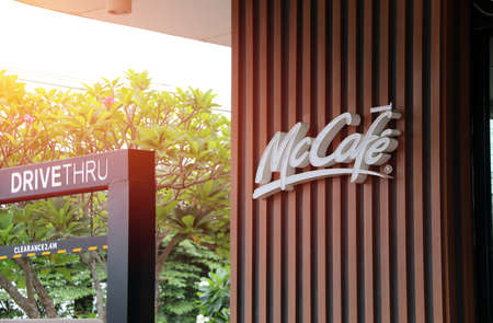Muang, Pathumthani,Thailand, April 1, 2018: Signboard name of McCafe DiveTHRU in PTT gas station. McCafe coffee shop is a part of McDonalds fast food restaurant.