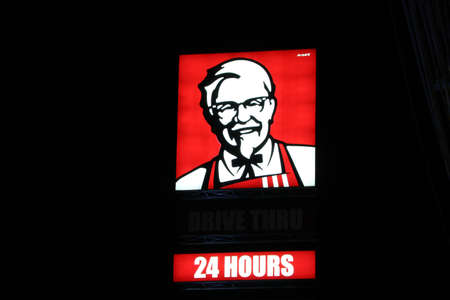 Nakhon Pathom, Thailand - Sep 17, 2017: The light box of  KFC drive thru shop at night, 24 hours service. Kentucky fried chicken is original an American fast food restaurant. Use Editorial only. Editorial