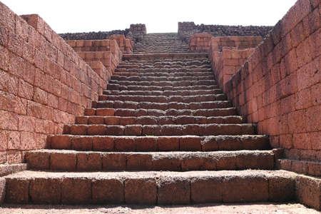 ancient laterite stone stairway up of the base of the main stupa, Khao Klang Nok, influence of Draravati culture, 8th-9th century A.D. in Petchaboon, Thailand.