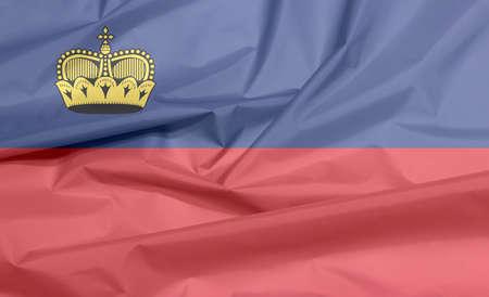 Fabric flag of Liechtenstein. Crease of Liechtensteiner flag background, blue and red, charged with a gold crown.