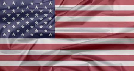 Fabric flag of United States of America. Crease of USA flag background, horizontal stripes of red and white with fifty white stars on a blue field.