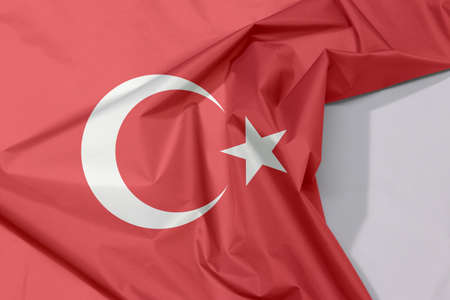 Turkey fabric flag crepe and crease with white space, a red field with a white star and crescent slightly left of center. Stock fotó