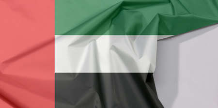 United Arab Emirates fabric flag crepe and crease with white space, green white and black with a vertical one fourth width red bar at the hoist. Stok Fotoğraf