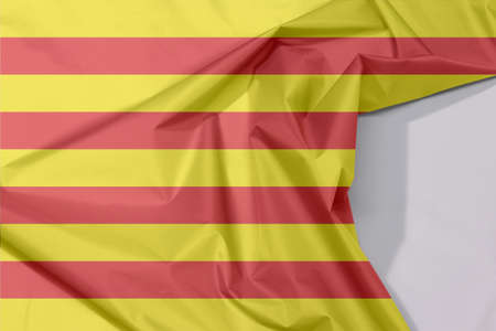 Catalunya fabric flag crepe and crease with white space, The red stripe on golden background.