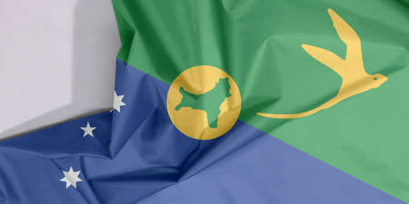 Christmas Island fabric flag crepe and crease with white space, Blue and green diagonal color with white star, bird in gold and shape of the island. Stock Photo