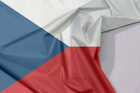 Czech Republic fabric flag crepe and crease with white space, two equal horizontal of white and red with a blue  triangle on the hoist side.