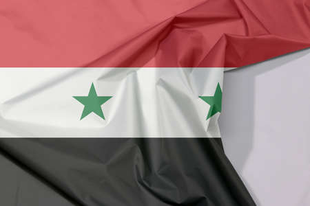 Syrian Arab Republic fabric flag crepe and crease with white space, A horizontal tricolor of red white and black with two green stars at the centre. Stock fotó