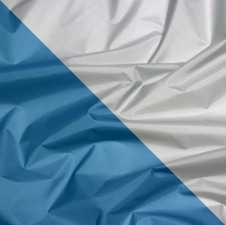 Fabric flag of Zurich. Crease of Zurich flag background, The canton of Switzerland Confederation.