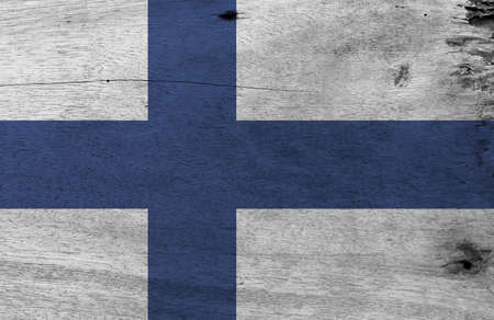 Flag of Finland on wooden plate background. Grunge Finland flag texture, Sea blue Nordic cross on a white field.