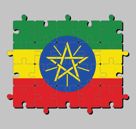 Jigsaw puzzle of Ethiopia flag in tricolor of green yellow and red with the National Emblem. Concept of Fulfillment or perfection.