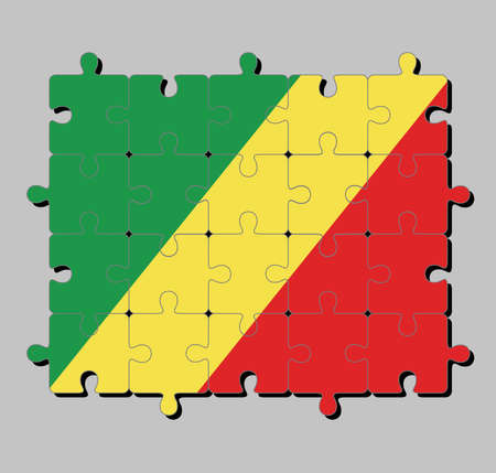 Jigsaw puzzle of Congo flag in diagonal of green, yellow and red. Concept of Fulfillment or perfection.