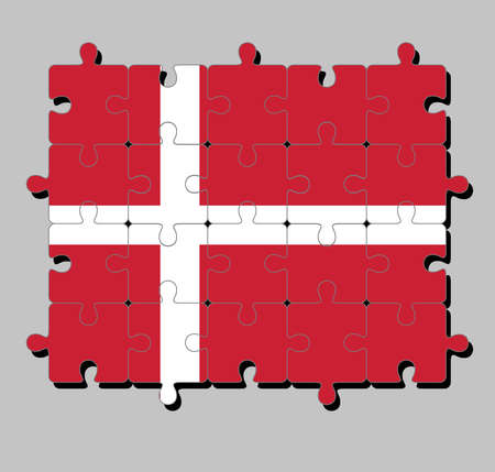 Jigsaw puzzle of Denmark flag in red with a white Scandinavian cross that extends to the edges of the flag. Concept of Fulfillment or perfection.