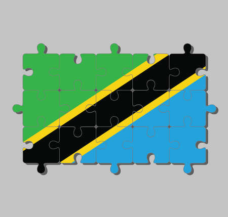 Jigsaw puzzle of Tanzania flag in a yellow-edged black diagonal band: triangle green and blue. Concept of Fulfillment or perfection.