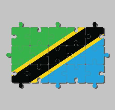 Puzzle der Tansania-Flagge in einem gelb umrandeten schwarzen diagonalen Band: Dreieck grün und blau. Konzept der Erfüllung oder Perfektion.
