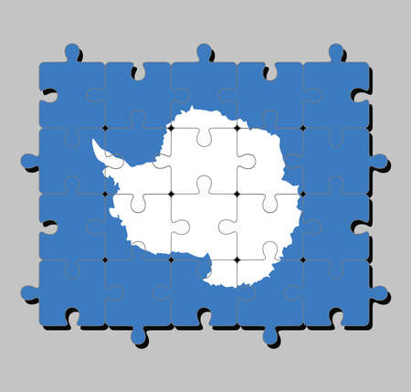 Jigsaw puzzle of Antarctica flag in a plain white map of the continent on a blue background. Concept of Fulfillment or perfection.
