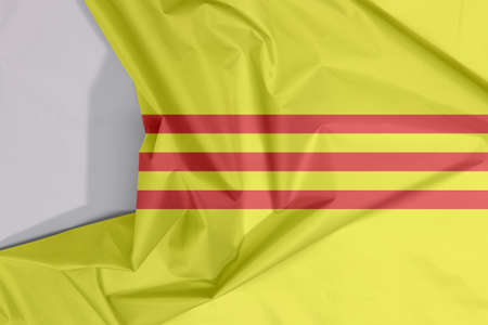 South Vietnam or Republic of Vietnam fabric flag crepe and crease with white space, yellow with three red stripes.