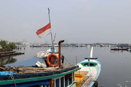 Indonesia fishing boat docked at the pier. Fishing boat landing at the harbor. Stock fotó