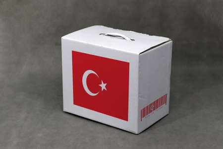 Turkish flag on white box with barcode and the color of Turkey flag, paper packaging for put products. The concept of export trading from Turkey.
