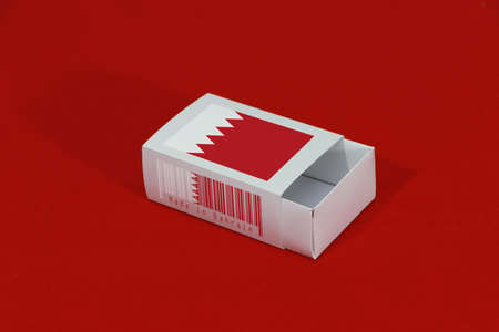 Bahrain flag on white box with barcode and the color of nation flag on red background, paper packaging for put match or products. The concept of export trading from Bahrain.