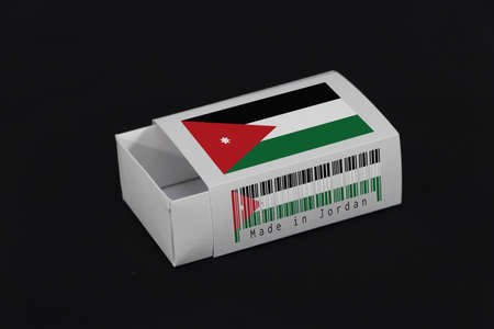 Jordan flag on white box with barcode and the color of nation flag on black background, paper packaging for put match or products. The concept of export trading from Jordan. Standard-Bild