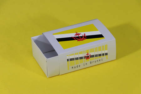 Brunei flag on white box with barcode and the color of nation flag on yellow background, paper packaging for put match or products. The concept of export trading from Brunei.