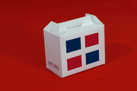 Dominican flag on white box with barcode and the color of nation flag on red background. The concept of export trading from Dominican, paper packaging for put products.