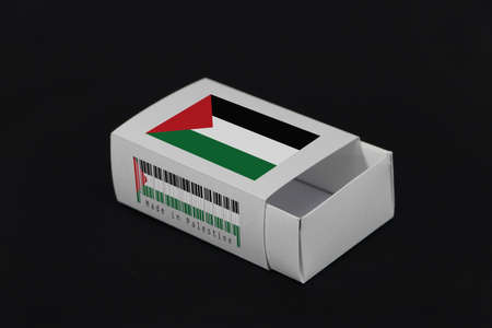 Palestine flag on white box with barcode and the color of nation flag on black background, paper packaging for put match or products. The concept of export trading from Palestine. Stock Photo