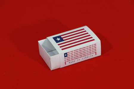 Liberia flag on white box with barcode and the color of nation flag on red background, paper packaging for put match or products. The concept of export trading from Liberia. Standard-Bild