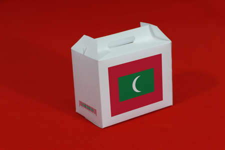 Maldives flag on white box with barcode and the color of nation flag on red background. The concept of export trading from Maldives, paper packaging for put products.