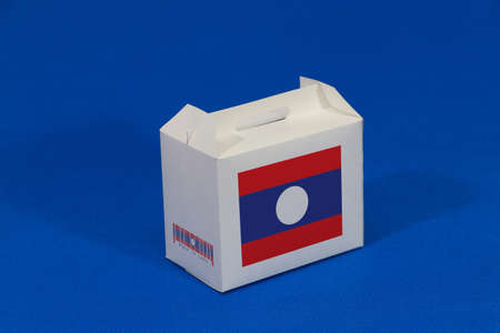 Laos flag on white box with barcode and the color of nation flag on blue background. The concept of export trading from Laos, paper packaging for put products.