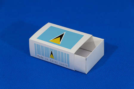 Saint Lucia flag on white box with barcode and the color of nation flag on blue background, paper packaging for put match or products. The concept of export trading from Saint Lucia.