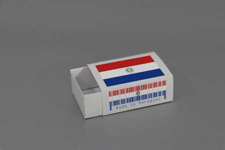 Paraguay flag on white box with barcode and the color of nation flag on grey background, paper packaging for put match or products. The concept of export trading from Paraguay.