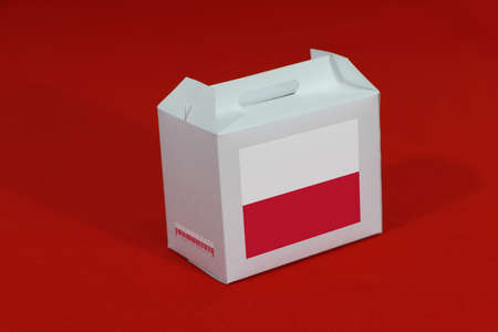 Poland flag on white box with barcode and the color of nation flag on red background. The concept of export trading from Poland, paper packaging for put products.