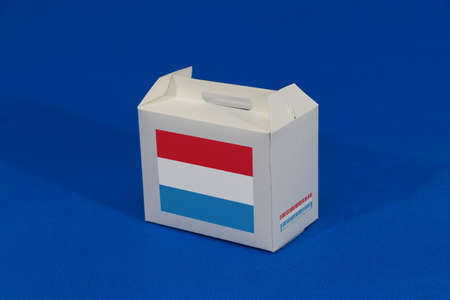 Luxembourg flag on white box with barcode and the color of nation flag on blue background. The concept of export trading from Luxembourg, paper packaging for put products.