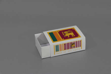 Sri Lanka flag on white box with barcode and the color of nation flag on grey background, paper packaging for put match or products. The concept of export trading from Sri Lanka.