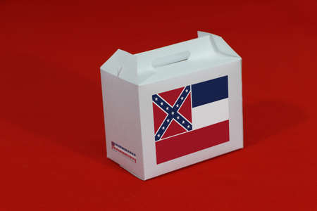 Mississippi flag on white box with barcode and the color of state flag on red background. The concept of export trading from Mississippi, paper packaging for put products. Stock Photo