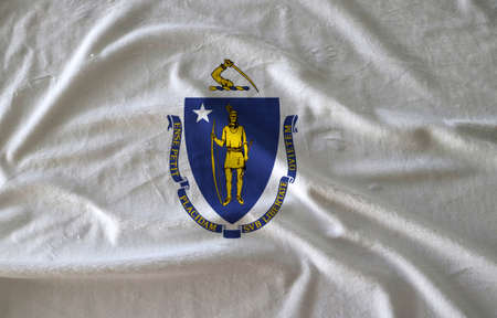 Towel fabric pattern flag of Massachusetts, Crease of Massachusetts flag background. The states of America, coat of arms centered on a white field.