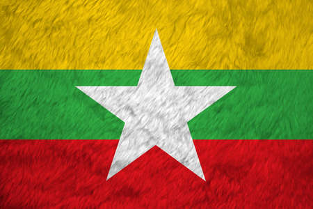 Towel fabric pattern flag of Myanmar, Crease of Myanmar flag background, red green and yellow color and white star. Фото со стока