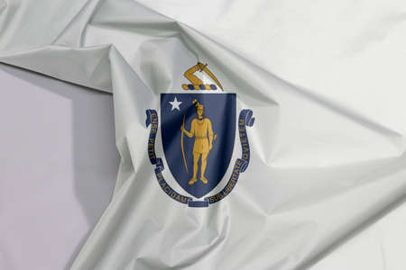 Massachusetts fabric flag crepe and crease with white space, the states of America. the state coat of arms centered on a white field.