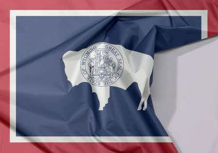 Wyoming fabric flag crepe and crease with white space, the states of America. The seal on American bison on blue with white and red.