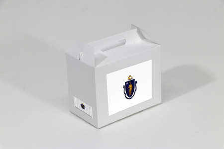 Massachusetts flag on white box with barcode and the color of state flag on white background. The concept of export trading from Massachusetts, paper packaging for put products.