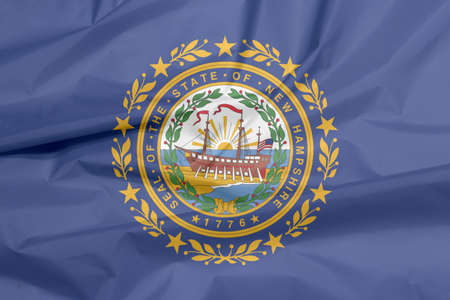 Crease of New Hampshire flag background, the states of America. The State Seal of New Hampshire on a blue field surrounded by Laurel leaves and nine stars.