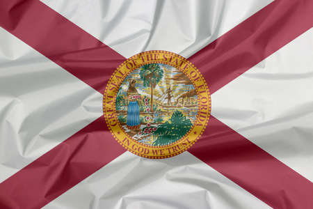 Crease of Florida flag background, the states of America. A red saltire on a white background, with the state seal superimposed on the center.
