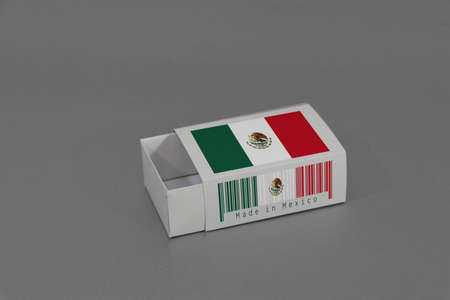 Mexico flag on white box with barcode and the color of nation flag on grey background, paper packaging for put match or products. The concept of export trading from Mexico.